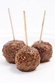 Three meatballs on toothpicks