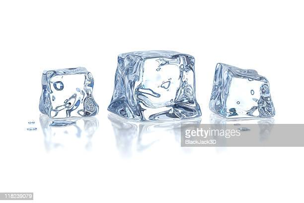 Three melting ice cubes isolated on white
