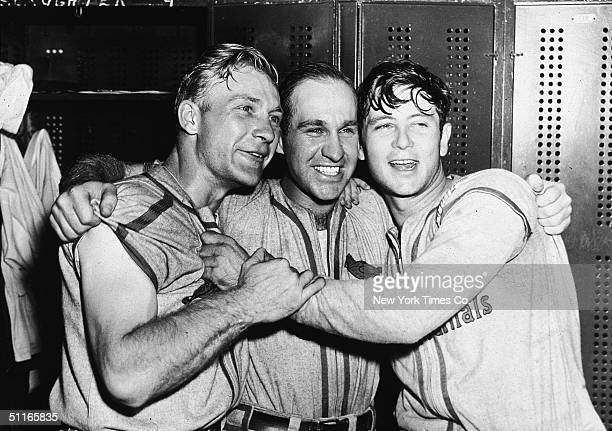 Three members of the victorious St Louis Cardinals baseball team in their locker room during the World Series early October 1942 From left Whitey...