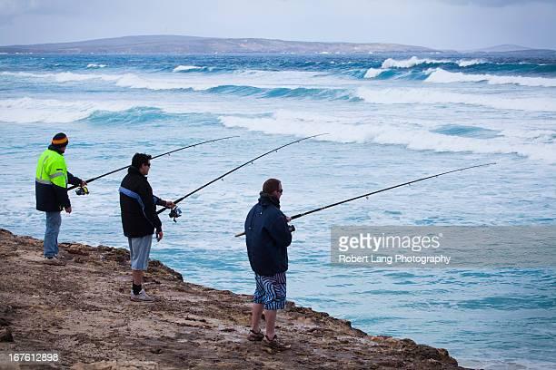 Three men fishing on rocks, Eyre Peninsula