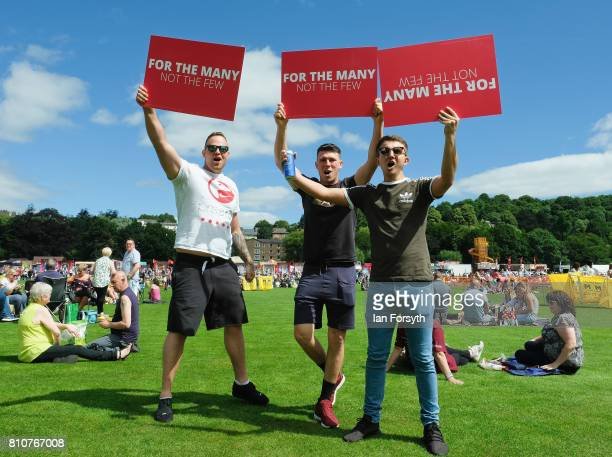 Three men hold Labour party placards during the 133rd Durham Miners Gala on July 8 2017 in Durham England Over two decades after the last pit closed...