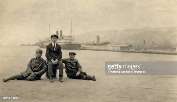 the place of arrival and departure for many emigrants The photograph very likely will be sent to their families remaining in the homeland Photography...