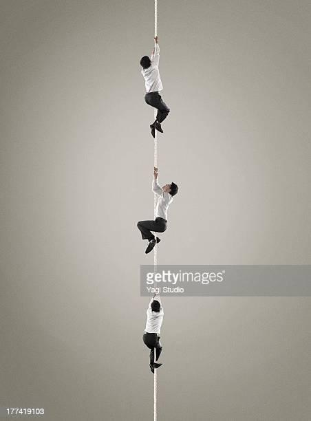 Three men who climb the rope