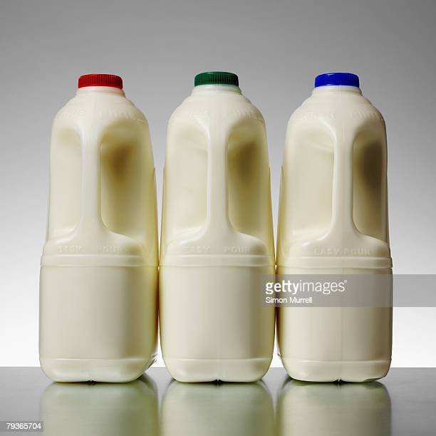 Three milk bottles indoors on table