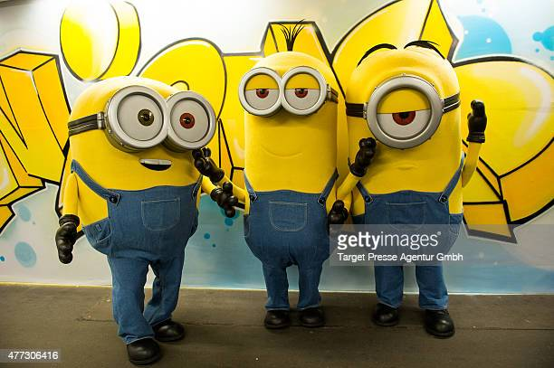 Three minions pose in the especially decorated underground station 'Mehringdamm' during a photocall for the film 'Minions' on June 16 2015 in Berlin...