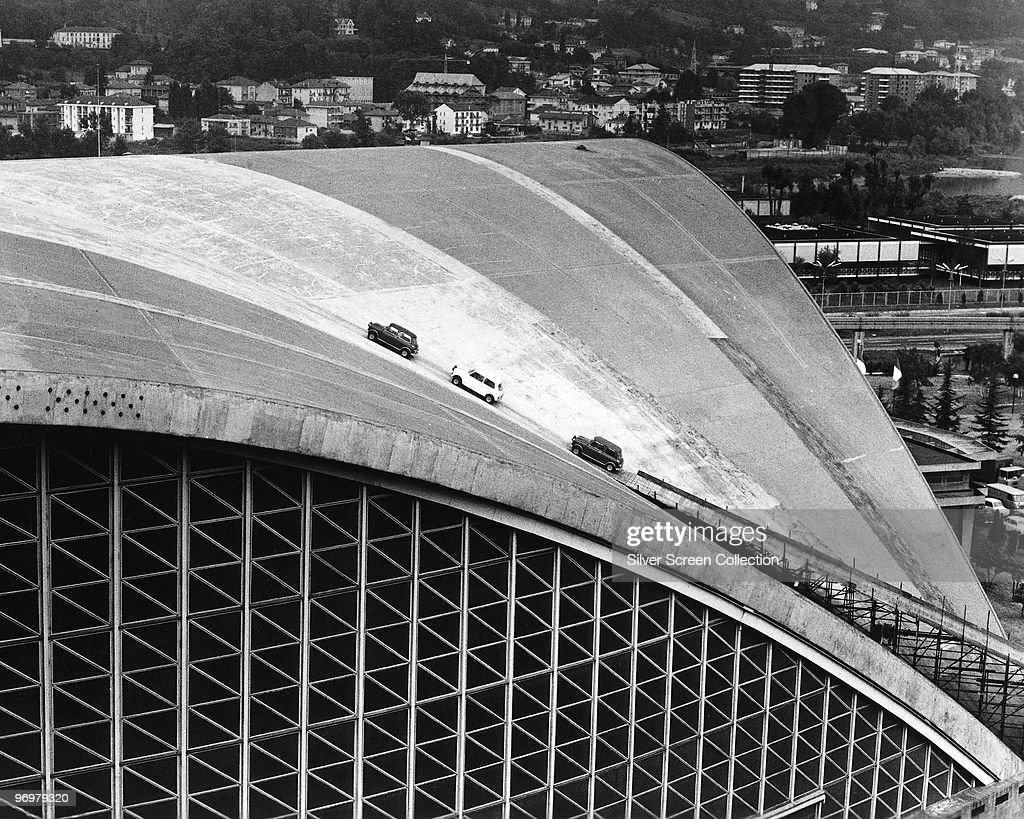Three minis climb the roof of the Palazzo a Vela (later the Torino Palavela) in Turin, in a scene from the British caper film 'The Italian Job', 1969.