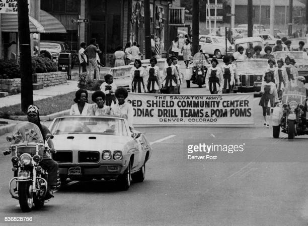 Three Miss Black Colorado Candidates are Gloria Lott Left Brenda Humburd Brenda Johnson Following convertible is Salvation Army's Red Shield...