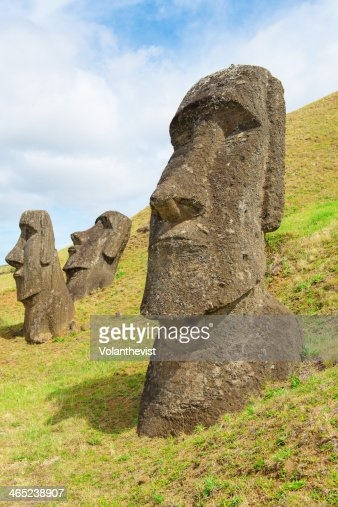 Three moai half buried in a quarry, Easter island