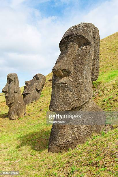 Three moai half buried in a quarry, Easter island