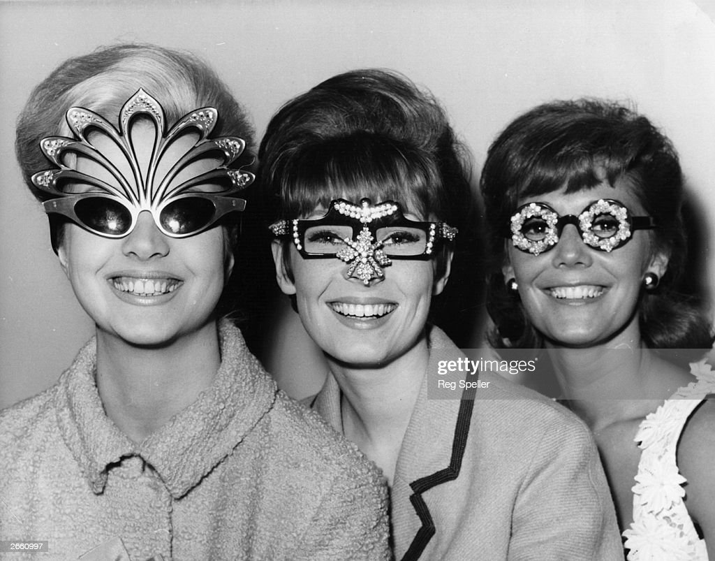 Three models at the Fashion and Spectacle Show, at the Mount Royal Hotel, London, seen wearing unusual spectacles.