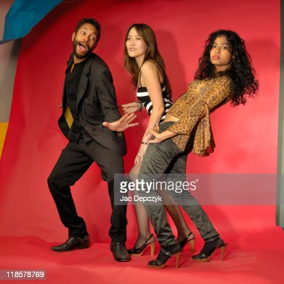 Three models dancing after a photo session : Stock Photo
