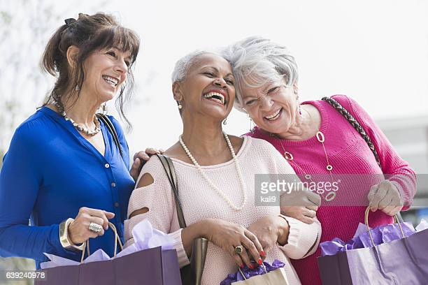 Three multi-ethnic senior women out shopping
