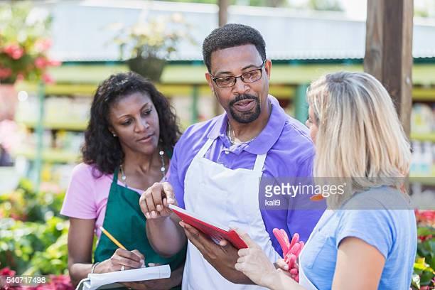 Three multi-ethnic workers in garden center