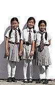 Three Nepal school girls in uniform smiling