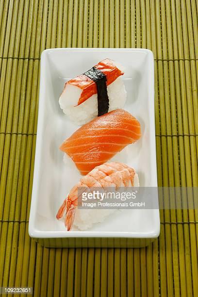 Three nigiri sushi in serving tray, close-up