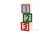 Three numbered building blocks on white background
