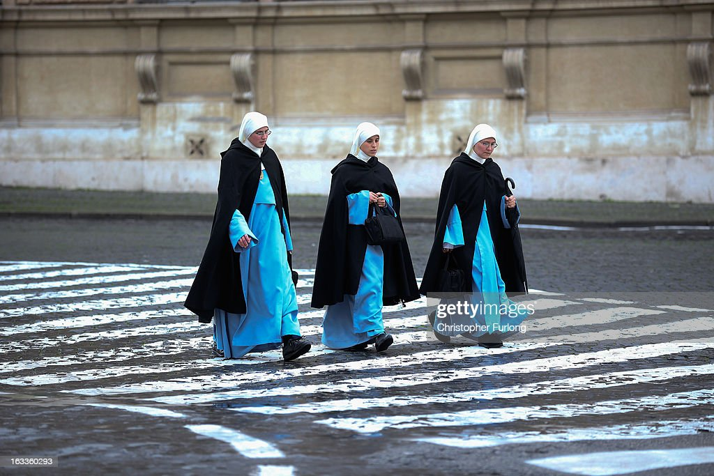 Three nuns walk to the Vatican on March 8, 2013 in Vatican City, Vatican. Cardinals are set to enter the conclave to elect a successor to Pope Benedict XVI after he became the first pope in 600 years to resign from the role. The conclave is scheduled to start on March 12 inside the Sistine Chapel and will be attended by 115 cardinals as they vote to select the 266th Pope of the Catholic Church.