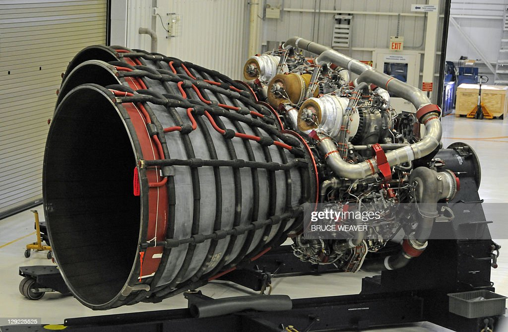 Three of the fifteen space shuttle main engines (SSME's) are viewed inside the engine shop on October 14, 2011 at Kennedy Space Center, Florida. NASA plans to use the shuttle main engines on their new heavy lift vehicle to go beyond Earth orbit. AFP PHOTO/Bruce Weaver