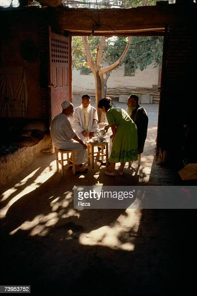 Three old men have tea in the Uzum district of Turpan on August 1995 in Turpan China