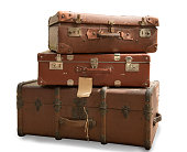 three old suitcases isolated on a white background