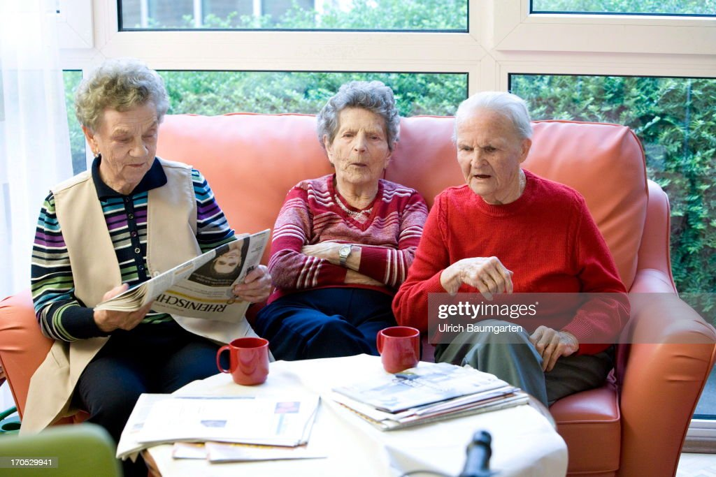 Three old women slitting on a sofa in the retirement home Haus Salem on May 17, 2013 in Ratingen, Germany.