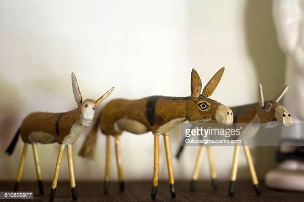 Three ornamental donkeys
