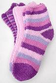three pairs of fluffy slipper socks