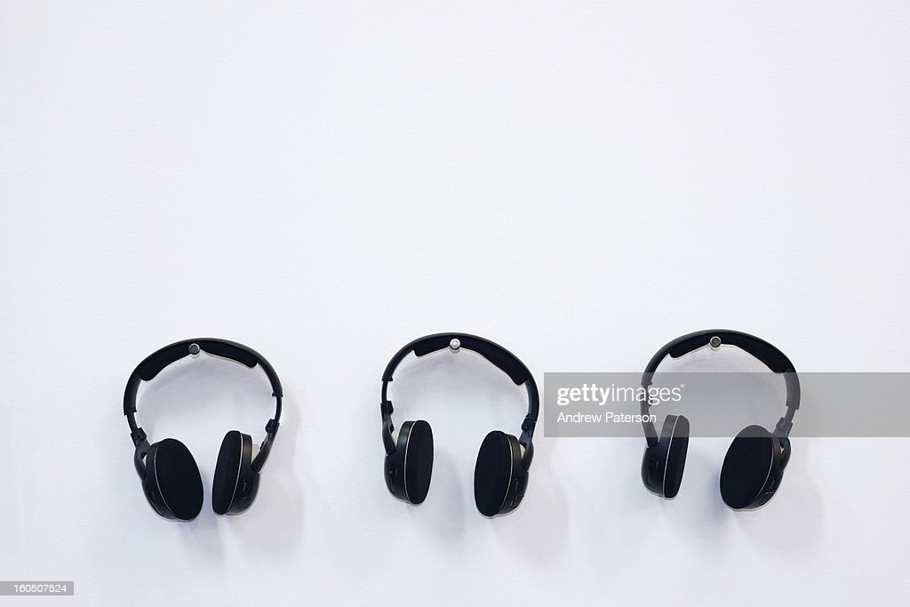 Three pairs of headphones : Stock Photo