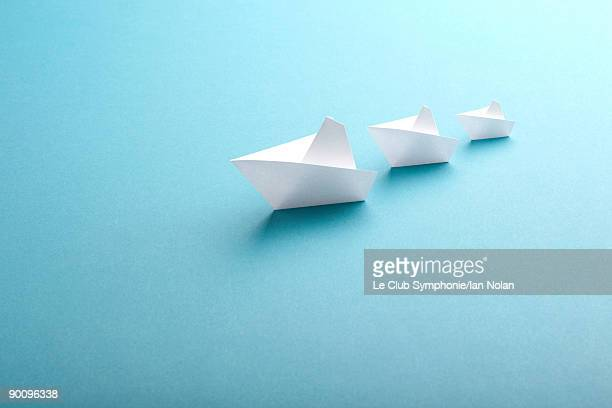 three paper boats