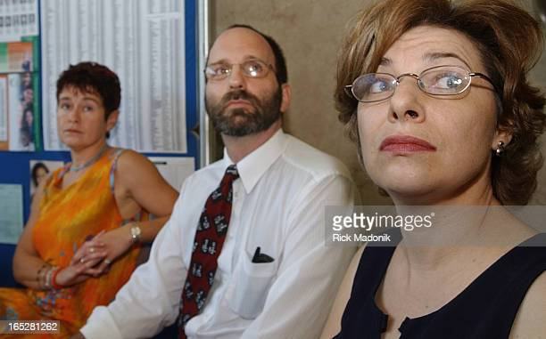 IMAGE 08/27/02 TORONTO ONTARIO Three parents who represent parents from various school boards hold a news conference at the Toronto District School...