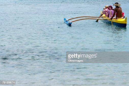 Three people canoeing in the sea, Captain Cook's Monument, Kealakekua Bay, Kona Coast, Big Island, Hawaii islands, USA : Stock Photo