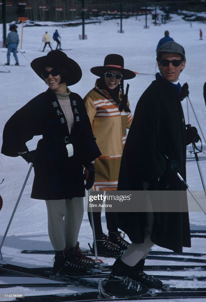 Three people each wearing sunglasses take to the slopes at Snowmass Village in Pitkin County Colorado in March 1968
