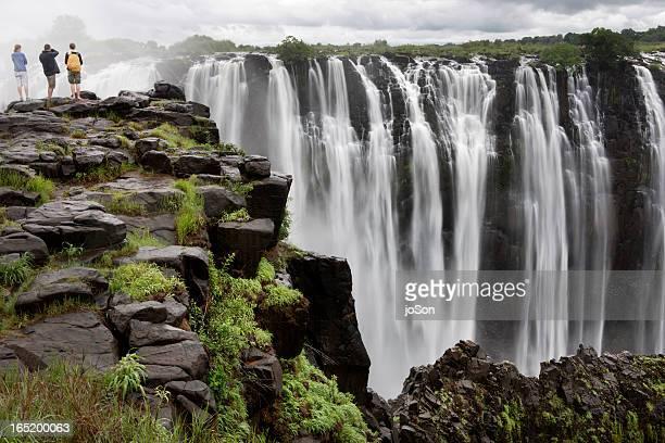 Three people looking at Victoria Falls, Zimbabwe,