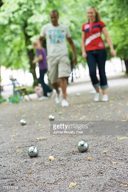 Three people playing boules Stockholm Sweden.