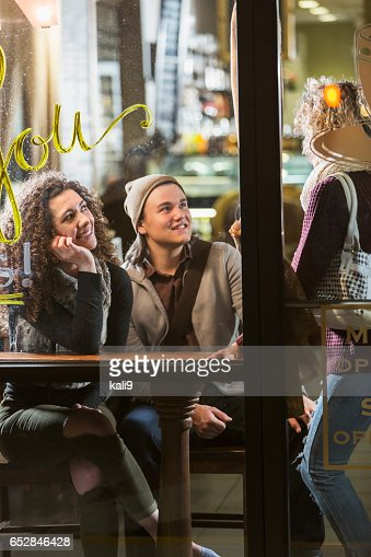 Three people talking in coffee shop : Stock-Foto
