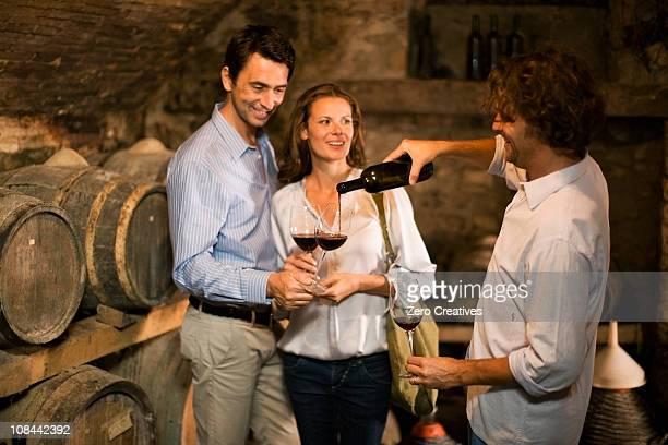 Three people tasting wine