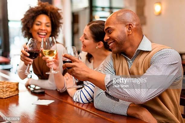 Three people toasting