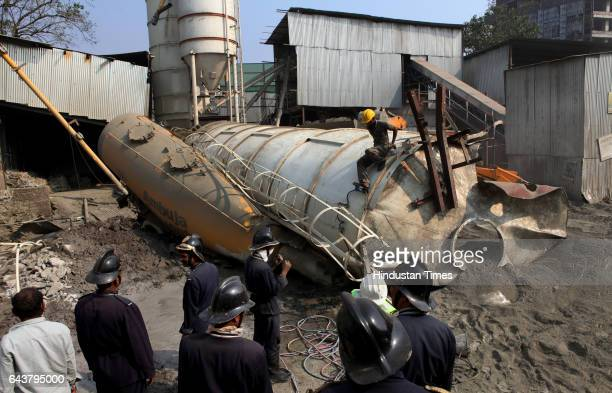 Three persons died after a cement mixing tank weighing 150 tonnes fell on a tanker in which the trio was sleeping