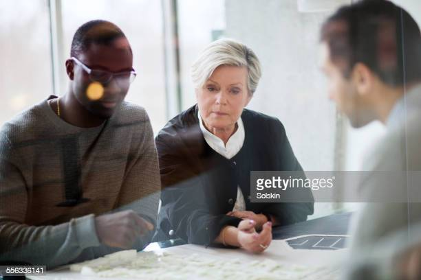 Three persons having office meeting