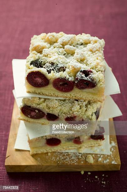 Three pieces of cherry crumble cake in a pile