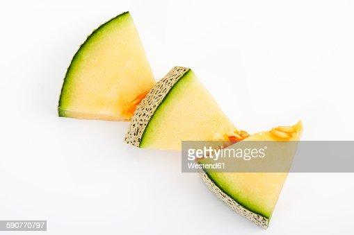 Three pieces of Galia Melon on white ground
