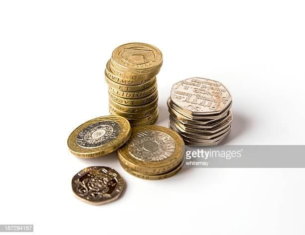 Drei Berge von Silber und gold-Münzen