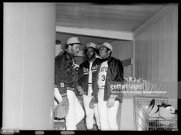 Three Pirates baseball players including no 8 Willie Stargell and no 3 in dugout Pittsburgh Pennsylvania circa 19701975