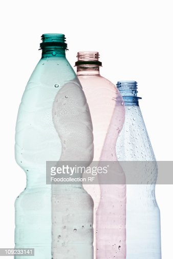 Three Plastic Bottles Against White Background Closeup ...