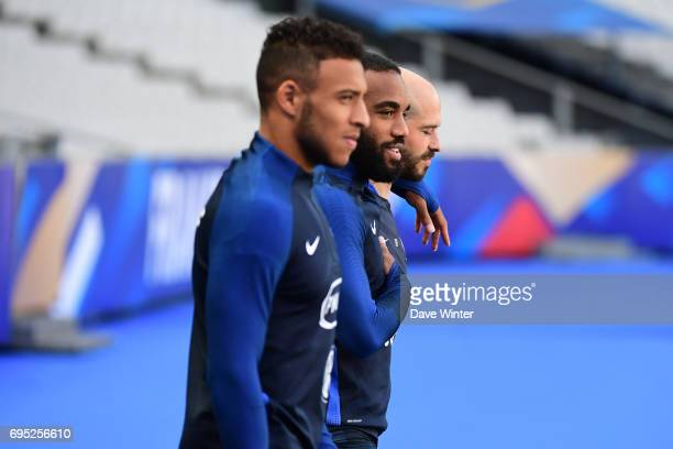 Three players from Olympique Lyonnais Corentin Tolisso Alexandre Lacazette and Christophe Jallet of France during the France training session at...