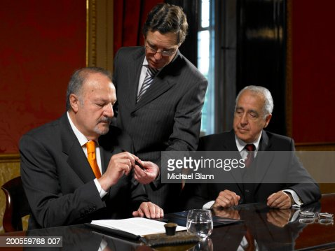 Three politicians at conference table