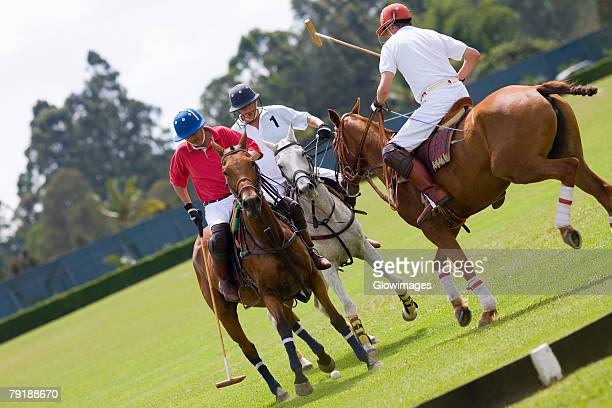 Three polo players playing polo