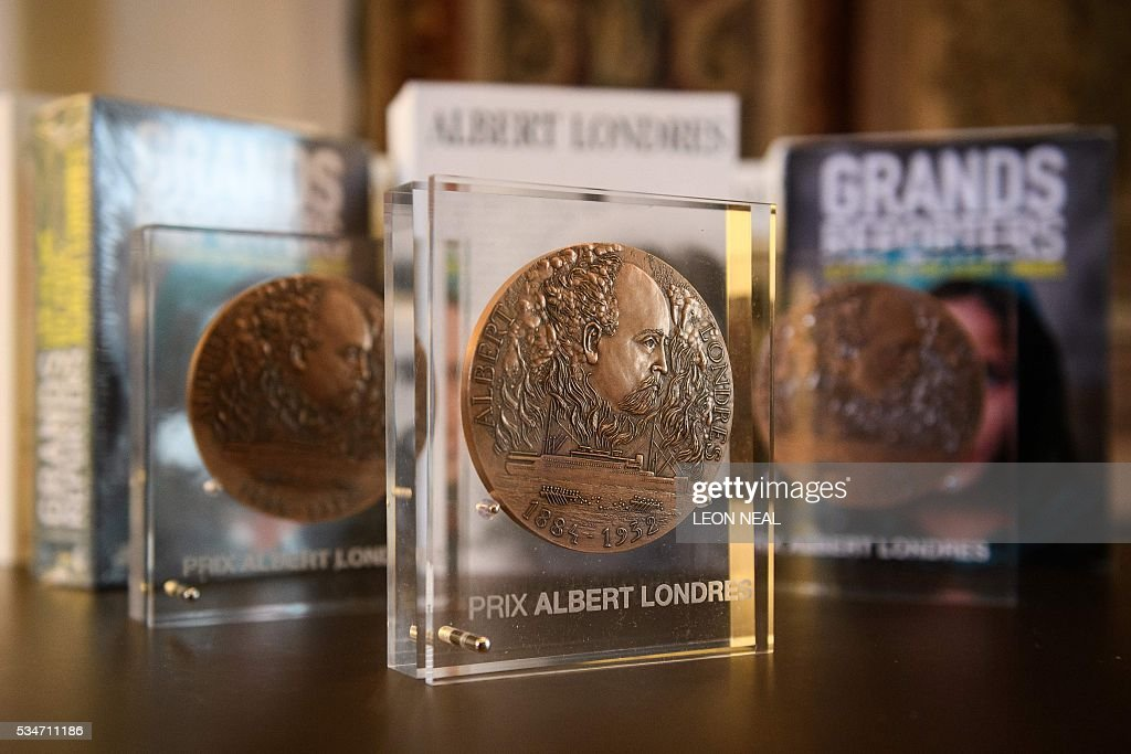 Three Prix Albert Londres awards are pictured ahead of the award ceremony for journalists Sophie Nivelle-Cardinale, Etienne Huver and Claire Meynial at the French Ambassador's residence in west London, on May 27, 2016. A series of reports from Africa and a film about the war in Syria were awarded the Prix Albert Londres for francophone journalists on Friday, as organisers drew attention to the need to protect whistle-blowers. / AFP / LEON