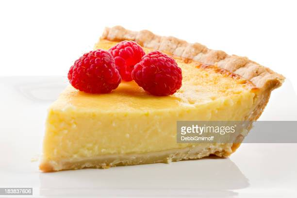 Three Raspberries On A Slice Of Custard Pie.
