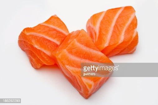 Three Raw Salmon sushi cubes
